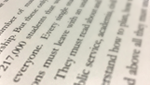 Blurred lines of text from the speech manuscript.