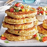Stack of corn cakes with salsa.
